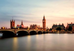 An image of London from across the Thames, showing the houses of parliament